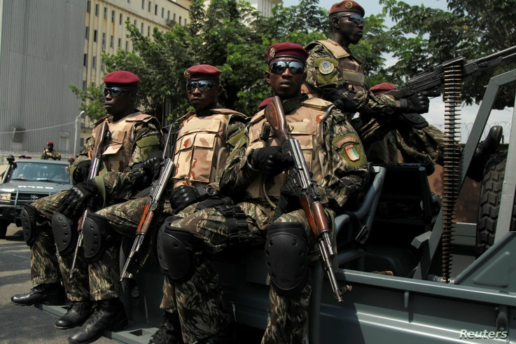 Soldiers of Ivory Coast presidential guard arrive at the port of Abidjan, Jan. 18, 2017.