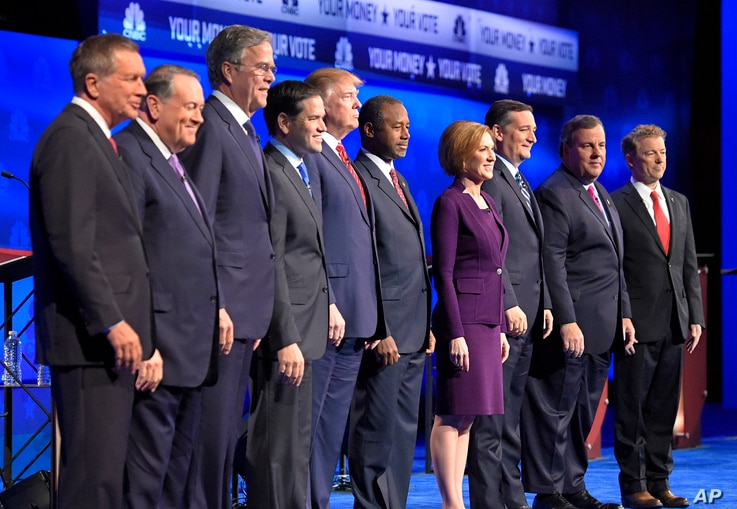From left, John Kasich, Mike Huckabee, Jeb Bush, Marco Rubio, Donald Trump, Ben Carson, Carly Fiorina, Ted Cruz, Chris Christie and Rand Paul take the stage during the CNBC Republican presidential debate in Boulder, Colo., Oct. 28, 2015.