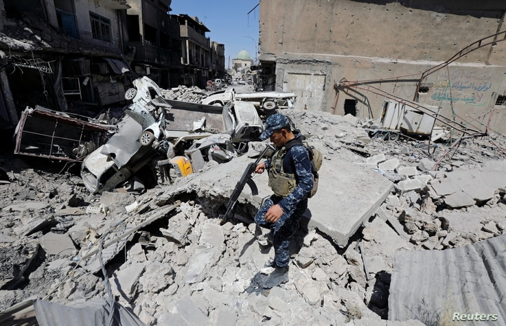 A member of Iraqi federal police patrols in the destroyed Old City of Mosul, Iraq, Aug. 7, 2017.