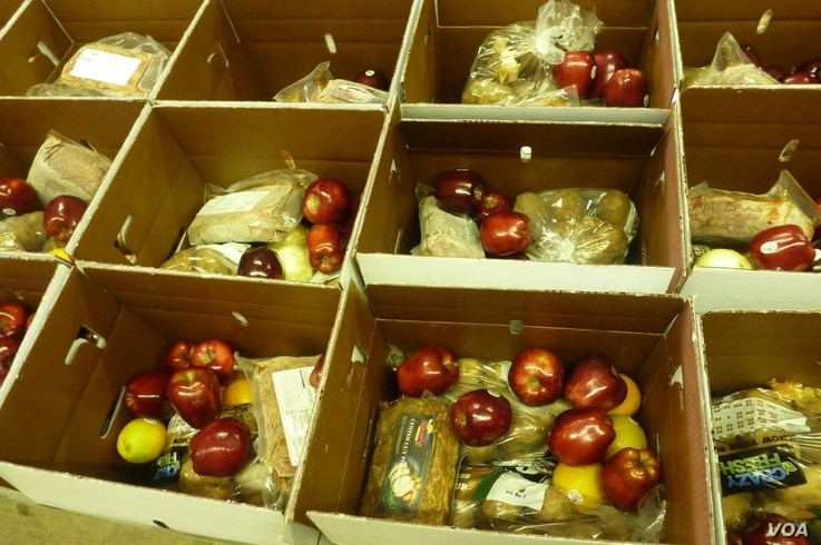 Food boxes, prepared by the Pine Ridge nonprofit organization One Spirit, to be distributed to Oglala Lakota tribal families in need. Courtesy:  One Spirit.