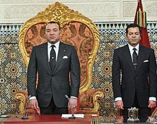 Morocco's King Mohamed VI with his Brother Prince Moulay Rachid, right, listens to the national anthem after he delivered a speech to the nation, March 9, 2011, at the king's Palace in Rabat