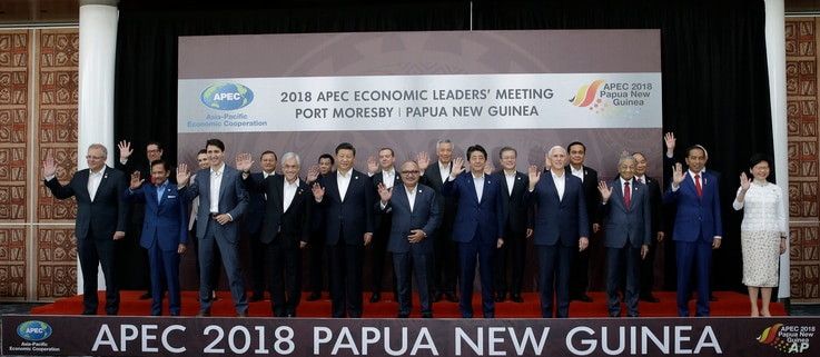 Leaders pose for a family photo at the APEC 2018 Economic Leaders Meeting at the APEC Haus at Port Moresby, Papua New Guinea, Nov. 18, 2018.