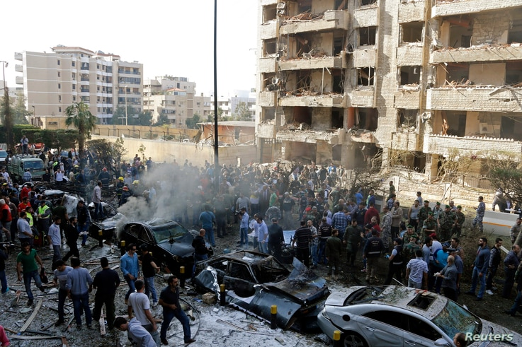 Soldiers, policemen and medical personnel gather at the site of explosions near the Iranian embassy in Beirut, Nov. 19, 2013.