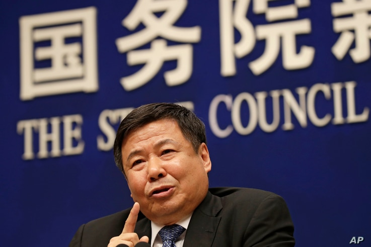 Chinese Finance Vice Minister Zhu Guangyao speaks during a press conference on Sino-US trade issues at the State Council Information Office in Beijing, April 4, 2018.