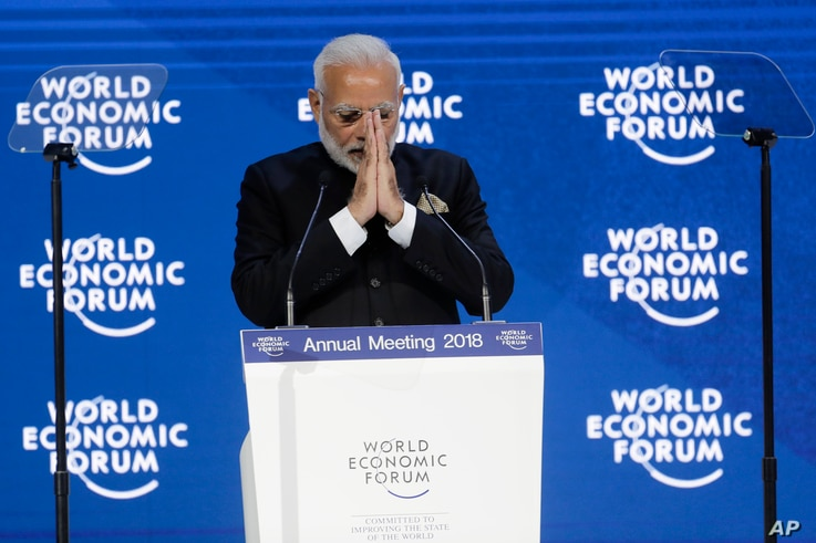 Prime Minister of India Narendra Modi greets the audience before his speech the World Economic Forum in Davos, Switzerland, Jan. 23, 2018.