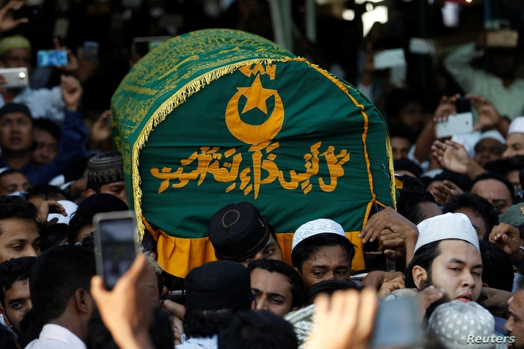 Supporters carry the coffin of Ko Ni, a prominent member of Myanmar's Muslim minority and legal adviser for Myanmar's ruling National League for Democracy, after he was shot dead, in Yangon, Myanmar, Jan. 30, 2017.