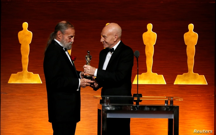 Actor Patrick Stewart, right, presents Jonathan Erland with the Gordon E. Sawyer Award at the Scientific and Technical Awards  in Beverly Hills, California, Feb. 10, 20