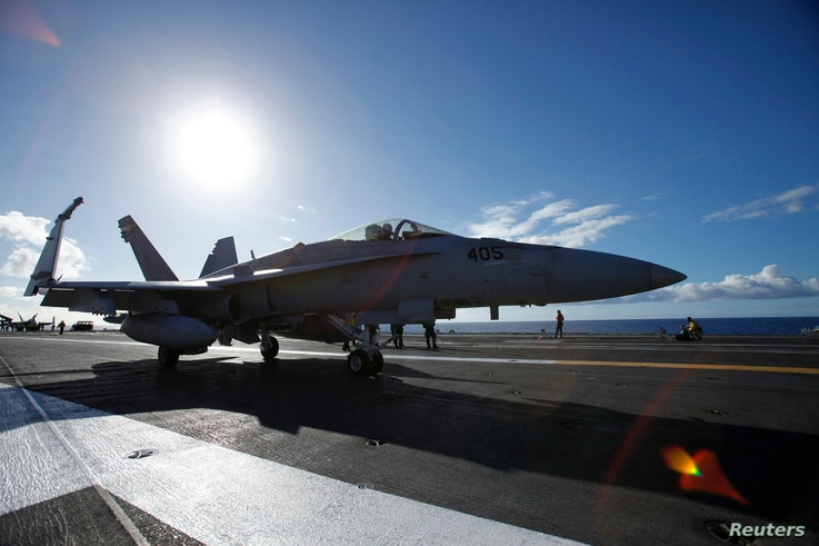 FILE - A F/A 18E Super Hornet on the aircraft carrier taxis on deck before take off, July 6, 2010.