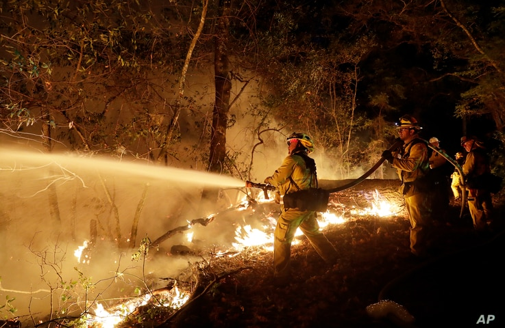 Fire crews battle a wildfire in Santa Rosa, California, Oct. 14, 2017.