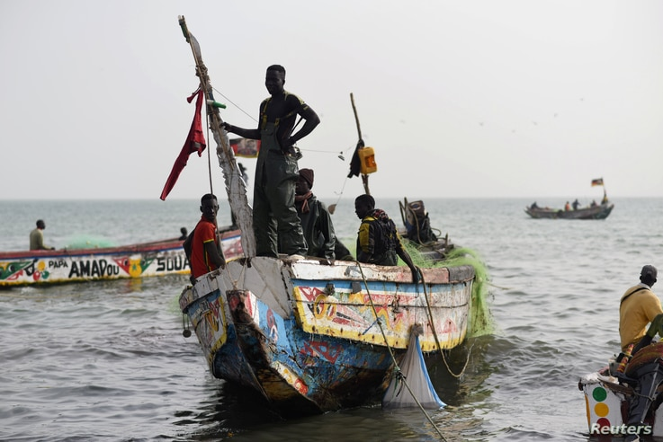 Fishermen land their boat at the beach near the coastal town of Joal-Fadiouth, Senegal, April 10, 2018.