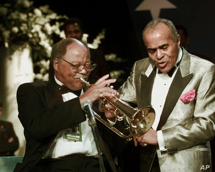FILE - Jon Hendricks sings with trumpeter Clark Terry and the Count Basie Band at the Texas Inaugural Ball, Jan. 20, 1997, in Washington.