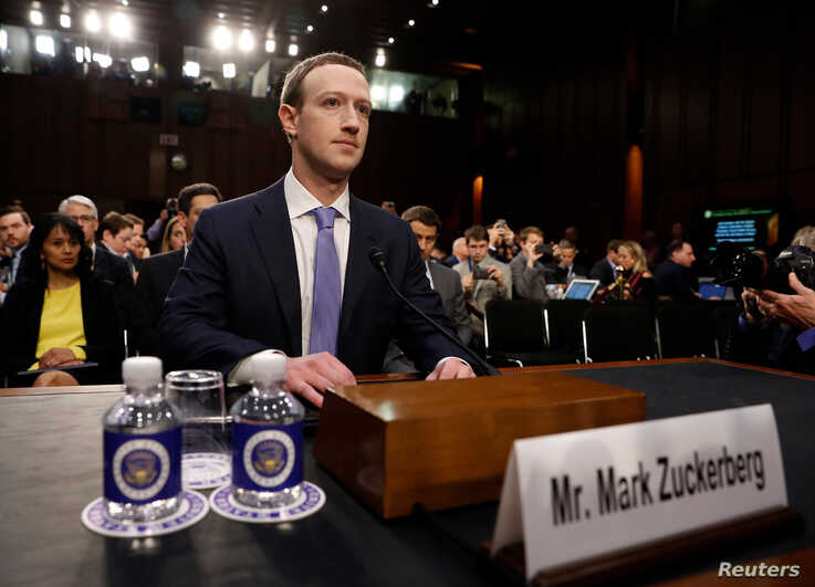 Facebook CEO Mark Zuckerberg arrives to testify before a Senate Judiciary and Commerce Committees joint hearing regarding the company's use and protection of user data, on Capitol Hill in Washington, April 10, 2018.