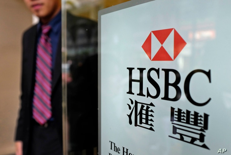 FILE - A man walks out from an HSBC branch office in Hong Kong. Mainland China's growing influence over the city and recent political demonstrations may have discouraged the bank from shifting its headquarters from London to Hong Kong.