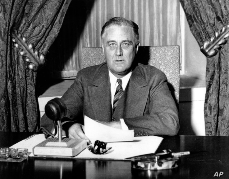 This photo was taken moments before U.S. President Franklin D. Roosevelt began his historic fireside chat to the American people on March 12, 1933.