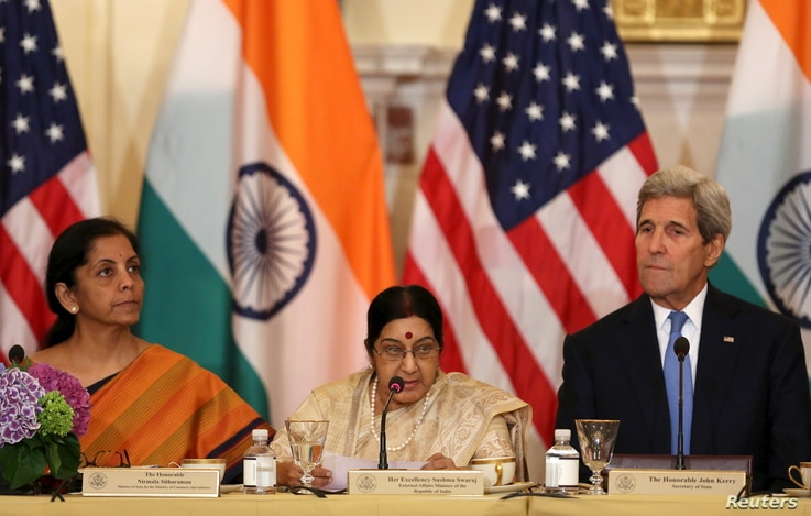 FILE - India's Minister of Commerce and Industry Nirmala Sitharaman, left, and External Affairs Minister Sushma Swaraj attend the U.S-India Strategic & Commercial Dialogue plenary session in Washington, Sept. 22, 2015.