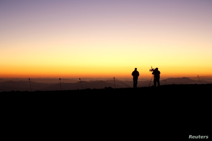 Members of the media work during the opening ceremony of the construction of The Giant Magellan Telescope (GMT) at Las Campanas hill near Vallenar town, Chile, Nov. 11, 2015.