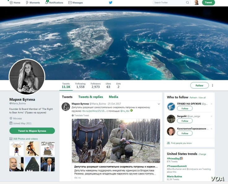 Posts are seen on Maria Butina's Twitter page. Butina has been arrested on charges of conspiring to act as an agent of the Russian government in the U.S. without notifying the attorney general.