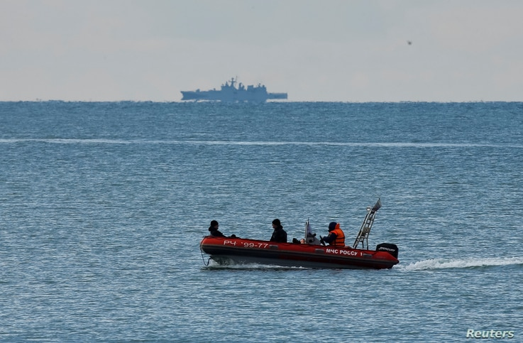 A boat of Russian Emergencies Ministry sails near the crash site of a Russian military Tu-154 plane, which crashed into the Black Sea on its way to Syria on Sunday. Forty-five ships and 135 divers from across Russia are involved in the search.