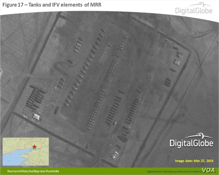 An image released by NATO on April 10, 2014 that shows tanks and infantry fighting vehicle elements of the Russian Motor Rifle Regiment near Kuzminka, Russia, near Ukraine. (DigitalGlobe/NATO ACO PAO)