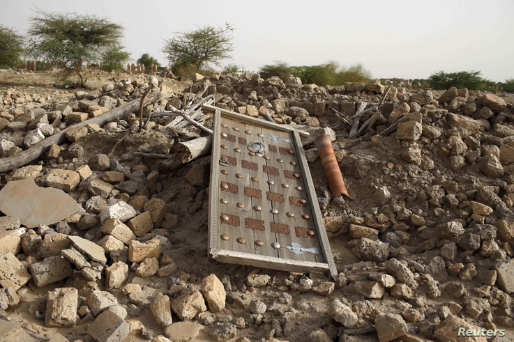 FILE - The rubble left from an ancient mausoleum destroyed by Islamist militants, is seen in Timbuktu, Mali, July 25, 2013.