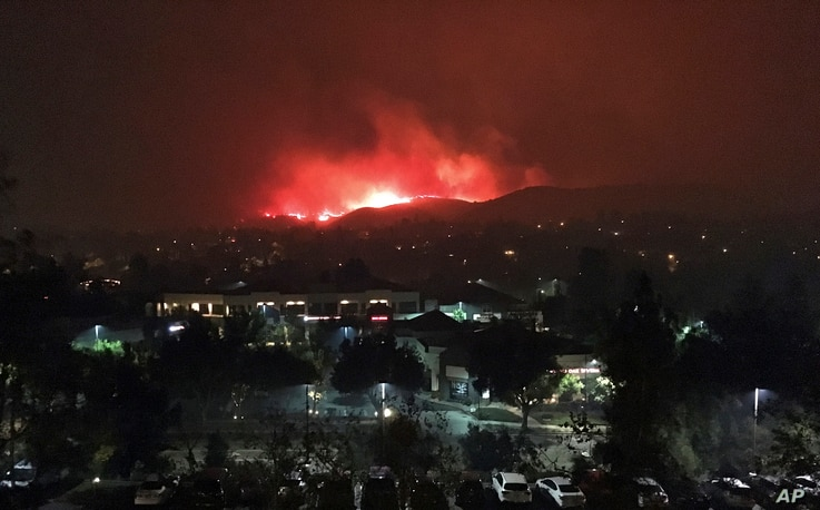 The Hill wildfire burns in the predawn hours on Nov. 9, 2018, seen from Agoura Hills in Southern California.