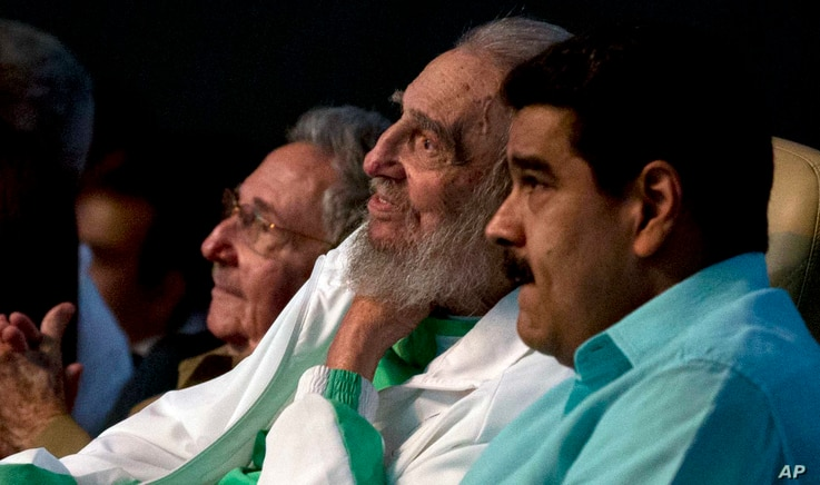Cuban Leader Fidel Castro, center, attends a gala for his 90th birthday, Aug. 13, 2016, accompanied by Cuba's President Raul Castro, left, and Venezuela's President Nicolas Maduro, right, at the 'Karl Marx' theater in Havana, Cuba.