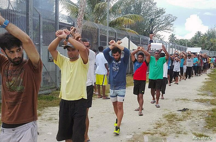 FILE - An undated image released Nov. 13, 2017, shows detainees staging a protest inside the compound at the Manus Island detention center in Papua New Guinea.