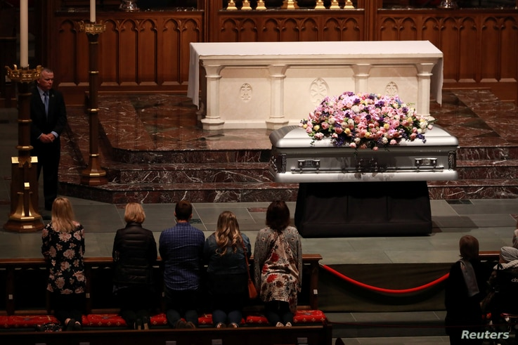 Members of the public visit Former U.S. first lady Barbara Bush, the wife of the 41st president, George H.W. Bush, and mother of the 43rd, George W. Bush, as she lies in repose at St. Martin's Episcopal Church in Houston, Texas, April 20, 2018.