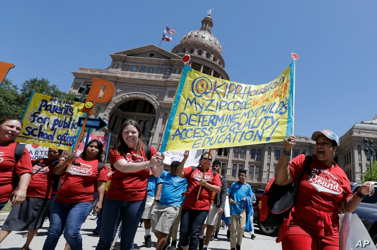 Students and faculty attend a rally on the steps of the Texas Capitol in support of charter schools, in Austin, April 26, 2017.