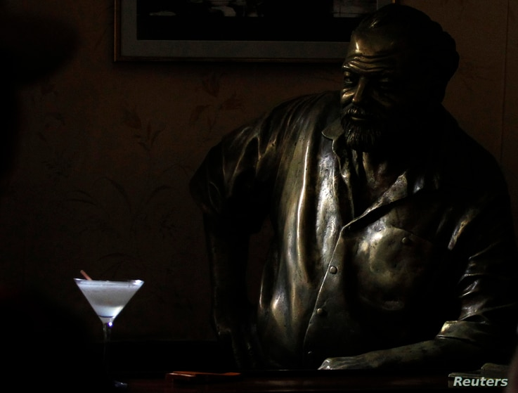 FIL E- A Daiquiri is seen on the counter beside a life-size bronze statue of United States writer Ernest Hemingway at his regular spot at The Floridita bar in Havana, July 1, 2010.