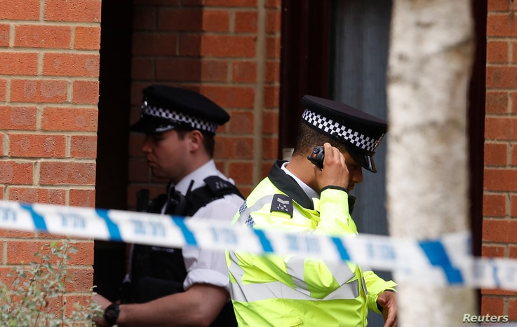 A police officer stands outside a property being searched after a man was arrested in connection with an explosion on a London Underground train, in Stanwell, near Heathrow airport, Britain, Sept. 17, 2017.