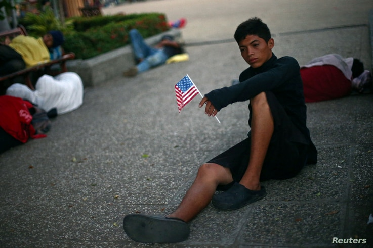 Norlan, 18, a migrant from Honduras en route to the United States, rests in a public square as he waits to regroup with more migrants, in Tecun Uman, Mexico, Oct. 26, 2018.