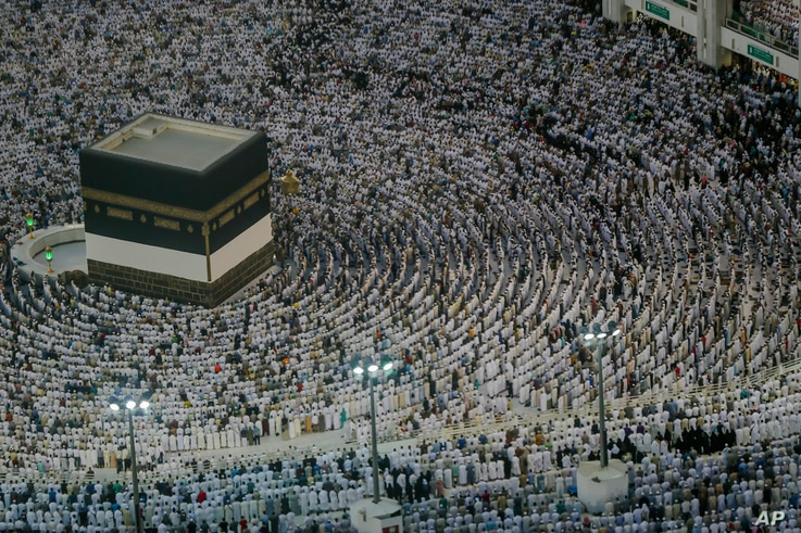 Muslim pilgrims pray at the Grand Mosque, ahead of the annual Hajj pilgrimage in the Muslim holy city of Mecca, Saudi Arabia, Muslim holy city of Mecca, Saudi Arabia, Saturday, Aug. 18, 2018. The annual Islamic pilgrimage draws millions of visitors e...