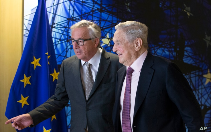 EU commission President Jean-Claude Juncker, left, welcomes George Soros, Founder and Chairman of the Open Society Foundation, prior to a meeting at EU headquarters in Brussels on Thursday, April 27, 2017.