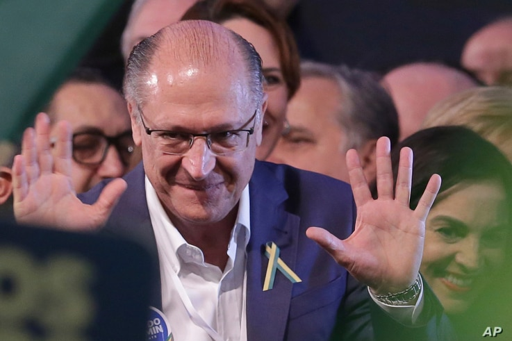 Brazil's Presidential candidate and former governor of Sao Paulo, Geraldo Alckmin, arrives to attend the national convention of the Social Democratic Party, in Brasilia, Brazil, Aug. 4, 2018.
