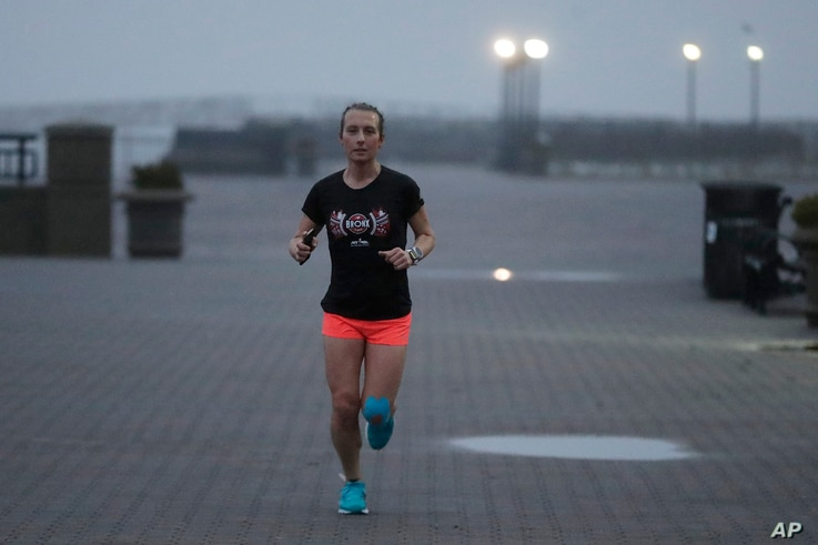 Amelia Gapin, a transgender woman from New Jersey, works out in early morning fog while preparing to run the Boston Marathon during a jog at Liberty State Park in Jersey City, New Jersey, April 18, 2017.