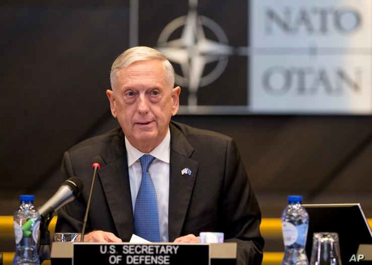 FILE - U.S. Secretary for Defense Jim Mattis addresses a round-table meeting in Brussels, June 8, 2018.