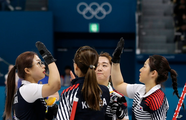 """South Korea's women's curling team celebrate after beating Russian athletes during their match at the 2018 Winter Olympics in Gangneung, South Korea, Feb.21, 2018. The team known as the """"Garlic Girls"""" came into the Pyeongchang Games as the underdog. ..."""