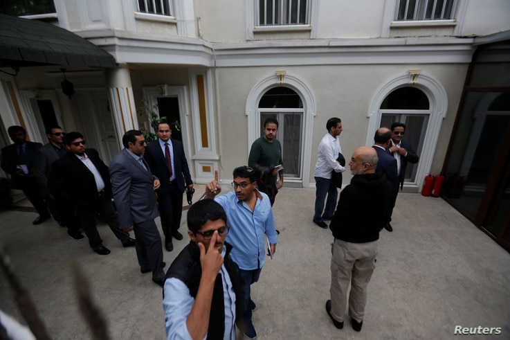 Saudi officials arrive at the residence of Saudi Arabia's Consul General Mohammad al-Otaibi in Istanbul, Oct. 17, 2018.