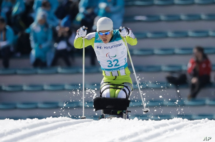 Ma Yu Chol of North Korea competes, March 14, 2018, in the qualification round of the men's 1.1km sprint, sitting, cross-country skiing at the 2018 Winter Paralympics in Pyeongchang, South Korea.