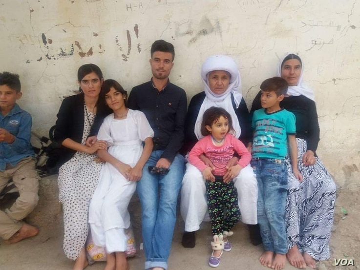 Dawood Saleh, a Yazidi from Sinjar who has resettled in the U.S., is pictured with his family in Sinjar before the Islamic State attack in 2014.