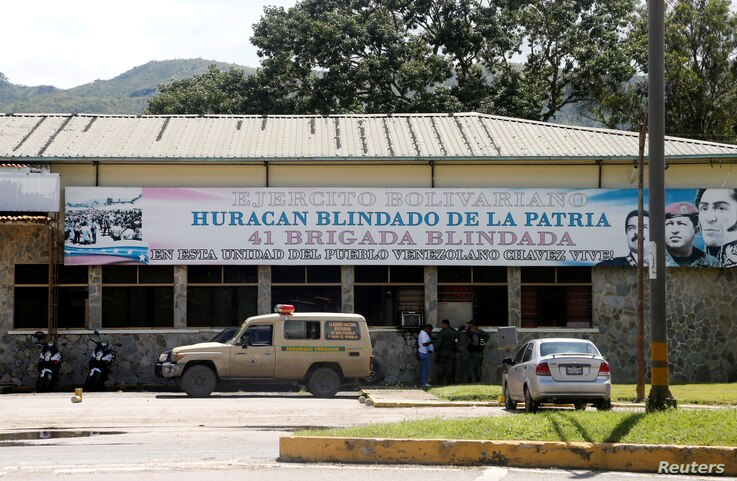 Members of security forces stand outside the 41 Brigada Blindada Fuerte Paramacay military base in Valencia, Venezuela, Aug. 6, 2017.
