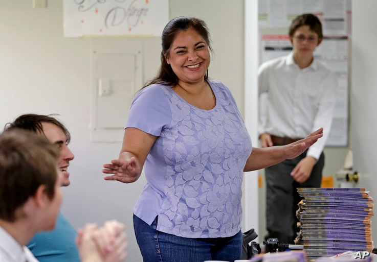 FILE - Democrat Manka Dhingra, a candidate for Washington state's 45th District Senate seat, talks with volunteers at her campaign headquarters in Redmond, Wash.