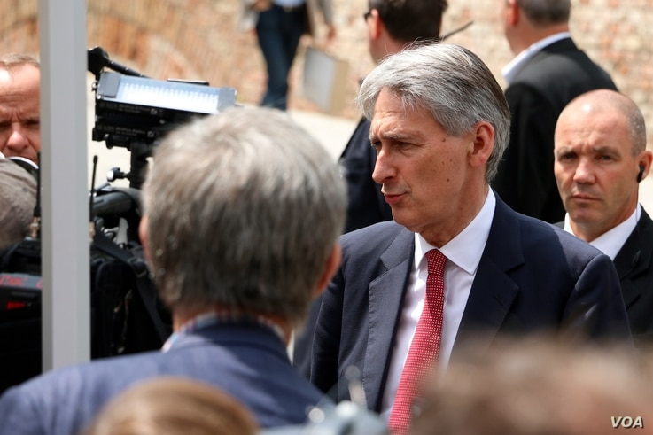 British Foreign Secretary Philip Hammond talks to reporters in Vienna, Austria, July 10, 2015.