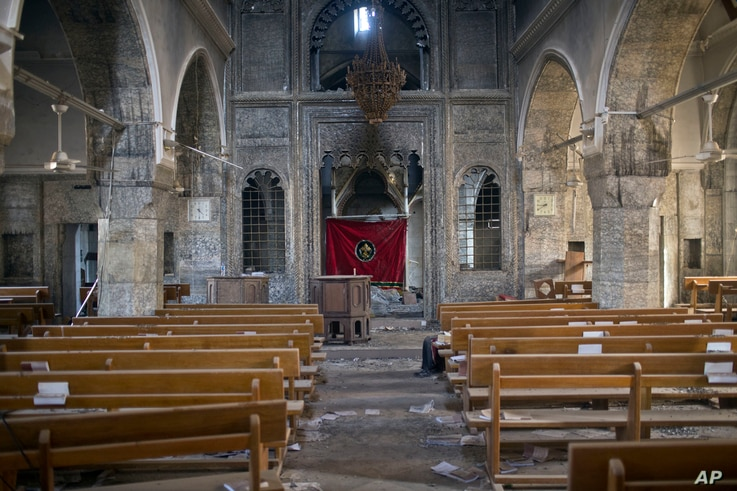 This photograph shows the inside of the church of Saint Shmoni, damaged by Islamic State fighters, in Bartella, Iraq, Oct. 22, 2016.