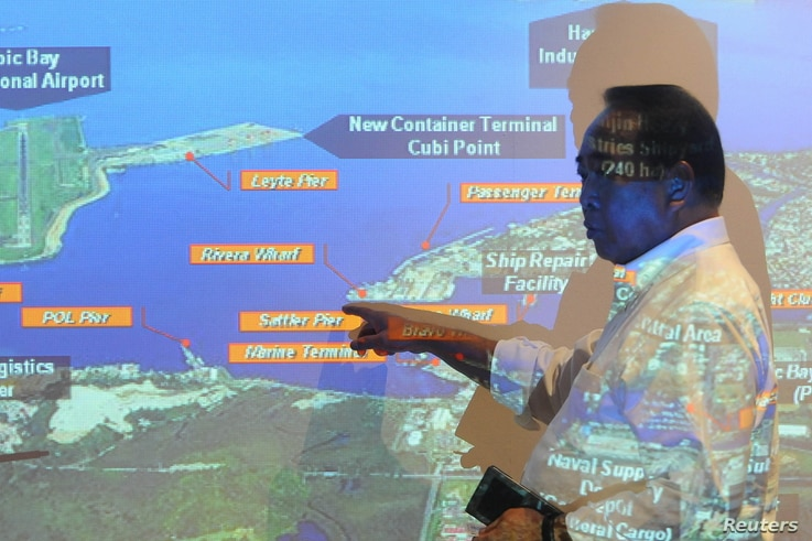 FILE - Subic Bay Metropolitan Authority (SBMA) chairman Roberto Garcia points at a map of Subic Bay during a forum in Subic Bay, Zambales province, north of Manila, Sept. 25, 2015.