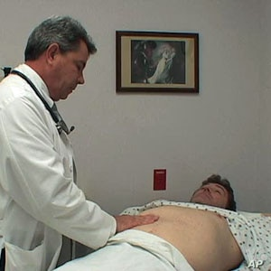 Professional actor Tom Wyatt acts the role of patient with Kurt Haspert, a nurse practitioner student.