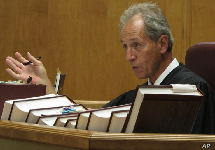 Shawnee County District Court Judge Franklin Theis rules from the bench July 11, 2014, in Topeka, Kan.
