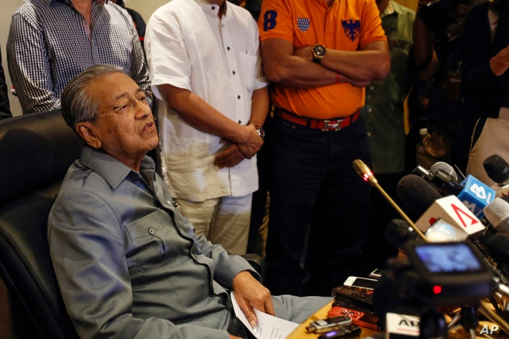 Former Malaysian prime minister Mahathir Mohamad speaks at a press conference in Putrajaya, Malaysia, Feb. 29, 2016. Mahathir has quit the country's ruling party, saying it has been hijacked by his embattled successor Najib Razak to protect his inter...