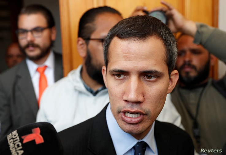 Venezuelan opposition leader and self-proclaimed interim president Juan Guaido talks to the media before a session of the Venezuela's National Assembly in Caracas, Jan. 29, 2019.